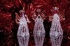Três anjos de vidro decorativos sobre Foto de Stock Royalty Free