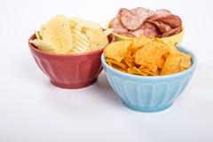 Três bacias de microplaquetas de batata dos vários sabores #2 fotos de stock royalty free