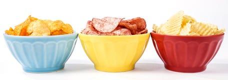 Três bacias de microplaquetas de batata dos vários sabores #1 foto de stock