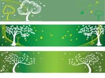 Três bandeiras verdes com árvores estilizados. ilustração stock