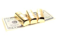 Três barras de ouro em contas de dólar Imagem de Stock