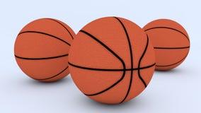 Três basquetebol no assoalho Fotos de Stock Royalty Free
