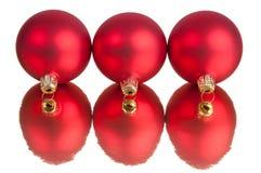 Três baubles vermelhos Foto de Stock Royalty Free