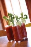 Três bebidas do cocktail de Mary sangrenta Imagem de Stock