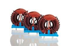 Três bobinas de bloqueador Toroidal industriais Fotos de Stock Royalty Free