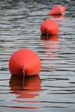 Três boias vermelhas Foto de Stock