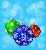 Três bolas do Natal com testes padrões diferentes Fotografia de Stock