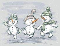 Três bonecos de neve Fotografia de Stock Royalty Free