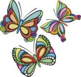 Três borboletas coloridas Fotos de Stock Royalty Free