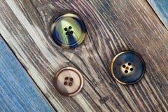 Três botões do vintage Fotografia de Stock
