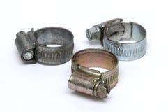 Três braçadeiras de mangueira do tipo de superfície diferente do chapeamento imagem de stock royalty free