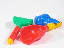 Três brinquedos da caixa de areia imagem de stock