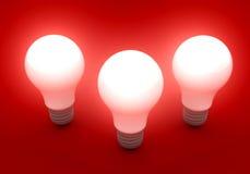 Três bulbos brilhantes Imagem de Stock