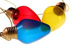 Três bulbos coloridos Imagem de Stock Royalty Free