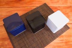 Três caixas coloridas do metal Fotografia de Stock Royalty Free