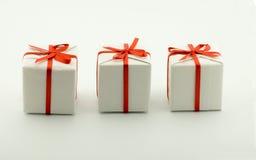 Três caixas com presentes imagem de stock