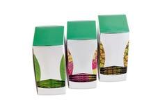 Três caixas do papelão dos saquinhos de chá com vário chá verde Imagens de Stock Royalty Free