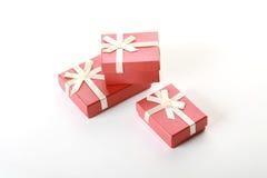 Três caixas festivas do terracotta sobre o branco Imagem de Stock