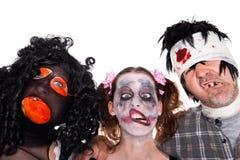 Três caras de criaturas assustadores do Dia das Bruxas foto de stock