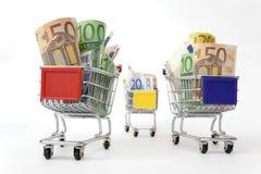 Três carros de compra com dinheiro Imagem de Stock
