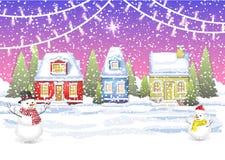 Três casas pequenas no campo do inverno Fotografia de Stock