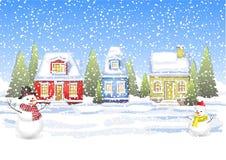 Três casas pequenas no campo do inverno Foto de Stock