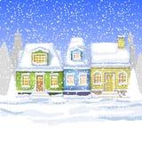 Três casas pequenas no campo do inverno Cartão do inverno Imagens de Stock