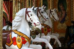 Três cavalos do carrossel imagem de stock royalty free