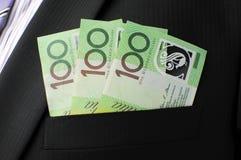 Três cem notas do dólar no bolso do terno de negócio Fotos de Stock