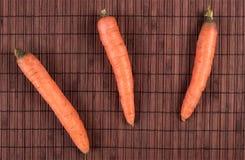 Três cenouras fotografia de stock royalty free