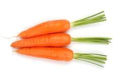 Três cenouras no fundo branco imagens de stock royalty free