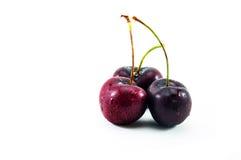 Três cerejas doces molhadas fotos de stock royalty free
