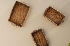 Três cestas que penduram na parede Fotos de Stock Royalty Free