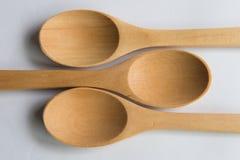 Três colheres da madeira natural Imagens de Stock