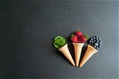 Três cones de gelado naturais Imagens de Stock
