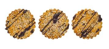 Três cookies com chocolate, sésamo, sementes de girassol isolaram o Imagem de Stock Royalty Free