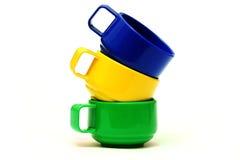 Três copos coloridos Imagem de Stock Royalty Free