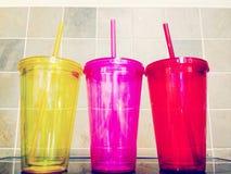 Três copos coloridos Imagem de Stock