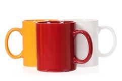 Três copos coloridos Fotografia de Stock Royalty Free