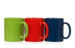 Três copos de café da cor Foto de Stock Royalty Free