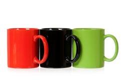 Três copos de café da cor Imagens de Stock Royalty Free
