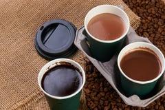 Três copos de café do cartão Imagens de Stock