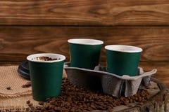 Três copos de café do cartão Imagem de Stock Royalty Free