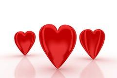 Três corações 3d vermelhos no fundo branco Foto de Stock Royalty Free