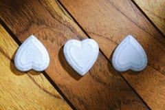 Três corações alinhados e invertidos Imagens de Stock