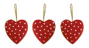 Três corações de madeira vermelhos Fotos de Stock Royalty Free