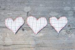 Três corações de matéria têxtil Fotos de Stock