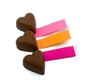 Três corações e notas do chocolate Fotografia de Stock