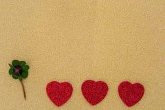 Três corações e um trevo Fotografia de Stock
