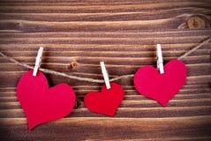 Três corações em tamanhos diferentes em uma linha Foto de Stock Royalty Free